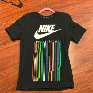 "Nike T-Shirt with ""International"" on front."